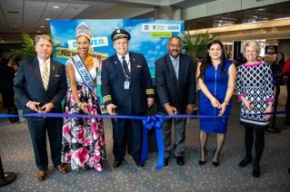 Ribbon Cutting celebration for the inaugural flight from Denver to Grand Cayman
